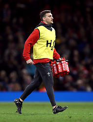 Wales' coach Sam Warburton brings on the water during the Guinness Six Nations match at the Principality Stadium, Cardiff.
