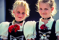 Bavarian girls wearing traditional dirndls, Garmisch-Partenkirchen, Bavaria, Germany.