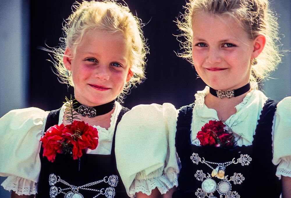 Bavarian girls wearing traditional dirndls, Garmisch-Partenkirchen, Bavaria, Germany.