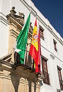 Flags outside the Ayuntiamiento, Plaza del Cabildo, village of Arcos de la Frontera, Cadiz province, Spain