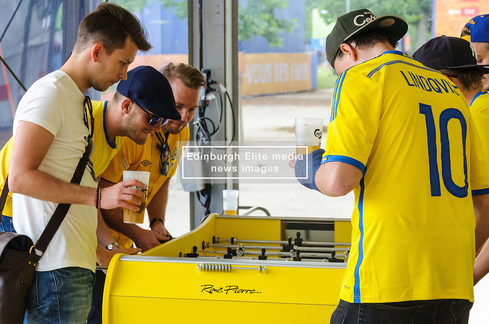 Sweden fans play table football at the Paris Fanzone, while waiting for the next game to start on the big screens. Images from the UEFA EURO 2016, 14 June 2016 in Fan Zone. (c) Paul Roberts | Edinburgh Elite media. All Rights Reserved