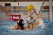Grinnell Women's Water Polo defends against a shot during their recent game versus Augustana College. BEN BREWER/Grinnell College