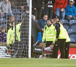 Raith Rovers Craig Wighton hurt after a tackle by Hibernian's Lewis Stevenson. <br /> Raith Rovers 1 v 2 Hibernian, Scottish Championship game played 24/10/2015 at Starks Park.