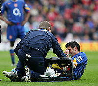 Photo. Andrew Unwin, Digitalsport<br /> Middlesbrough v Arsenal, Barclays Premiership, Riverside Stadium, Middlesbrough 09/04/2005.<br /> Arsenal's Jose Reyes (R) receives treatment after a body-check from Middlesbrough's Franck Queudrue.