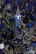 Aerial view of the Chrysler Building and 101 Park Avenue in New York City photographed from a helicopter at night.