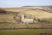 St Brendan's parish church standing alone in Exmoor national  park hills, Brendon, Devon, England