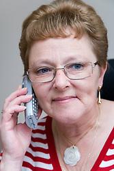 Older woman wheelchair user making a phone call,