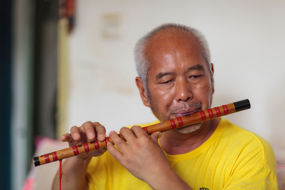 """Duan is described as a """"local legend"""" by friends and neighbours. He became blind at the age of 40 years after suffering glaucoma. He said """"I felt bad because I could not see. I felt troubled because I was unable to do simple tasks"""". As a result of various therapeutic services, Duan now walks with a cane and has a cleaning job at a local college, where his daughter works as a teacher. He has learned to play the flute, the cucurbit and Chinese cello. He says, """"I am so happy because I've started working and my family is very happy for me. I encourage people who learn from the miracle that has fallen over me""""."""