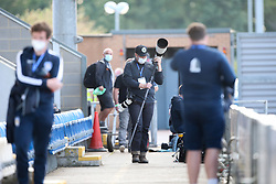 A photographer is seen pitchside wearing a face mask - Mandatory by-line: Arron Gent/JMP - 18/06/2020 - FOOTBALL - JobServe Community Stadium - Colchester, England - Colchester United v Exeter City - Sky Bet League Two Play-off 1st Leg
