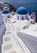 High angle view of the Ekklisia (church) Analipsi with classic staircase, Oia, Santorini, Greece