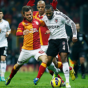 Galatasaray's Emre Colak (L) and Besiktas's Manuel Fernandes (R) during their Turkish superleague soccer derby match Galatasaray between Besiktas at the TT Arena at Seyrantepe in Istanbul Turkey on Sunday, 27 January 2013. Photo by Aykut AKICI/TURKPIX