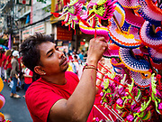05 FEBRUARY 2019 - BANGKOK, THAILAND: A toy vender sells New Year's toys on Yaowarat Road in Bangkok.  Chinese New Year celebrations in Bangkok started on February 4, 2019, although the city's official celebration is February 5 - 6. The coming year will be the Year of the Pig in the Chinese zodiac. About 14% of Thais are of Chinese ancestry and Lunar New Year, also called Chinese New Year or Tet is widely celebrated in Chinese communities in Thailand.       PHOTO BY JACK KURTZ