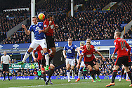 Phil Jagielka of Everton (l) and Jose Salomon Rondon of West Bromwich Albion jump for the ball. Barclays Premier League match, Everton v West Bromwich Albion at Goodison Park in Liverpool on Saturday 13th February 2016.<br /> pic by Chris Stading, Andrew Orchard sports photography.