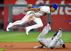 Apr 8, 2019; Kansas City, MO, USA; Kansas City Royals second baseman Adalberto Mondesi (27) catches out Seattle Mariners designated hitter Edwin Encarnacion (10) trying to steal second base in the third inning at Kauffman Stadium. Mandatory Credit: Denny Medley-USA TODAY Sports