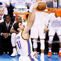 08 May 2016: Oklahoma City Thunder center Enes Kanter (11) dunks the ball during the Oklahoma City Thunder 111-97 victory over the San Antonio Spurs, during Game Four of the Western Conference Semifinals of the NBA Playoffs at the Chesapeake Energy Arena, Oklahoma City, Oklahoma, USA.