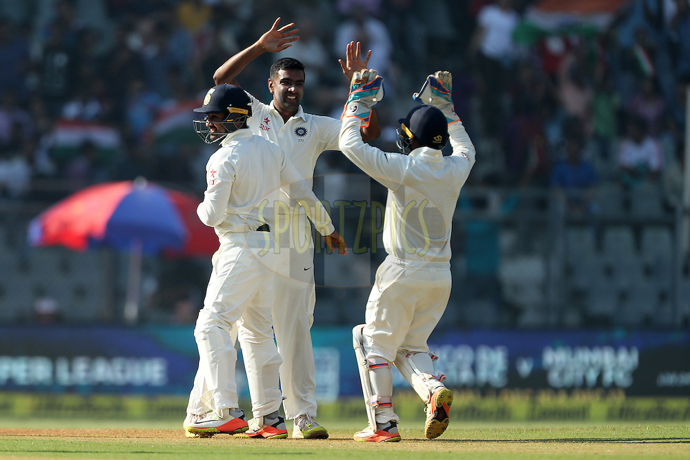 Ravichandran Ashwin of India celebrates the wicket of Adil Rashid of England during day 5 of the fourth test match between India and England held at the Wankhede Stadium, Mumbai on the 12th December 2016.<br /> <br /> Photo by: Ron Gaunt/ BCCI/ SPORTZPICS