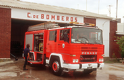 Fire engine and firefighter at fire station,