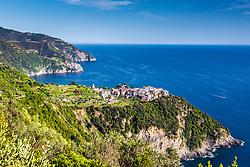 Cornigilia and Manarola clinging to the cliffs of Cinque Terre above the Tyrrhenian Sea on the Italian Riviera of northern Italy.