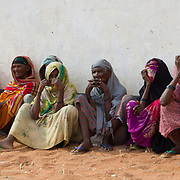 Elderly women wait patiently for their relief during the East African drought. Wajir, North Eastern Kenya.