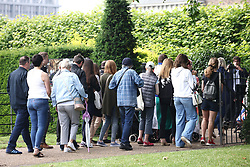 © Licensed to London News Pictures. 02/07/2021. London, UK. Members of the public queue to enter the grounds of Kensington Palace to view a new statue of Diana, Princess of Wales, which was unveiled by Prince William and Prince Harry hearsay afternoon. Photo credit: Ben Cawthra/LNP