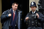 © Licensed to London News Pictures. 20/03/2013. Westminster, UK. Jeremy Hunt, Conservative MP, Secretary of State for Health (Left)..Chancellor Of The Exchequer George Osborne poses for photographers whilst holding his red ministerial box outside 11 Downing Street In London, before presenting his annual budget to parliament today 20th March 2013. Photo credit : Stephen Simpson/LNP