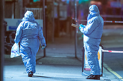 © Licensed to London News Pictures. 05/02/2020. London, UK. Forensic investigators gather evidence after the Metropolitan Police Service was called to Kingsley Rd in Hounslow at 19:23GMT on Tuesday 4th Feb to reports of a fight. A 19-year-old man then self-presented at a hospital with stab injuries. One person has been arrested. Photo credit: Peter Manning/LNP