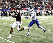ATLANTA, GA - DECEMBER 31:  Wide receiver Derel Walker #11 of the Texas A&M Aggies catches a fourth quarter touchdown pass behind Breon Borders #31 of the Duke Blue Devils during the Chick-fil-A Bowl game at the Georgia Dome on December 31, 2013 in Atlanta, Georgia.  (Photo by Mike Zarrilli/Getty Images)