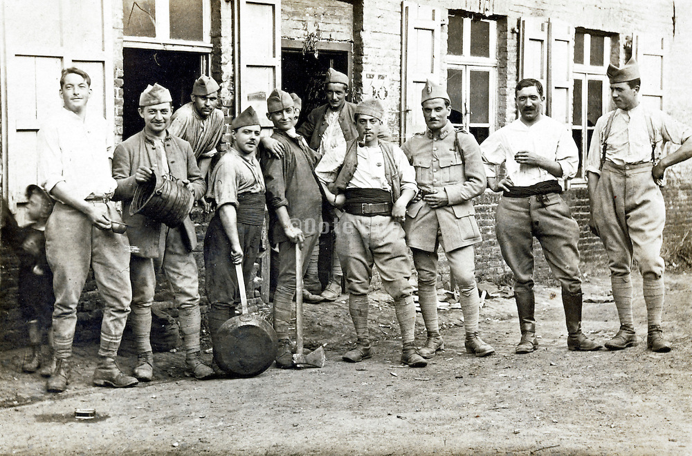 French soldiers and kitchen hands posing casually together 1910s