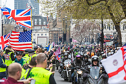 "© Licensed to London News Pictures. 12/04/2019. London, UK. Hundreds of bikers on Whitehall for a ""rolling thunder"" protest in support of ""Soldier F"", a former British soldier who may be charged over Bloody Sunday killings. Photo credit: Rob Pinney/LNP"