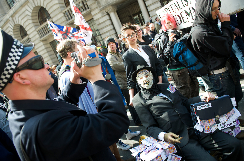 Thousands of protesters marched the streets from London Bridge to the Bank of England on the first day of the G20 Summit.  Many were decked out in garb themed by the four horses of the apocalypse.  Police lined the streets in anticipation of violence.