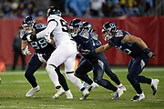 Jacksonville Jaguars rookie defensive tackle Taven Bryan (90) gets double team blocked by Tennessee Titans tight end Luke Stocker (88) and Titans tight end MyCole Pruitt (85) as he rushes during the week 14 regular season NFL football game against the Tennessee Titans on Thursday, Dec. 6, 2018 in Nashville, Tenn. The Titans won the game 30-9. (©Paul Anthony Spinelli)