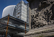 Monument and modern construction site in the City of London.