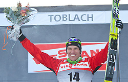 05.01.2011, Nordic Arena, Toblach, ITA, FIS Cross Country, Tour de Ski, Qualifikation Sprint Women and Men, im Bild am Podium Devon Kershaw (CAN, #6), winner, Platz 1. EXPA Pictures © 2011, PhotoCredit: EXPA/ J. Groder
