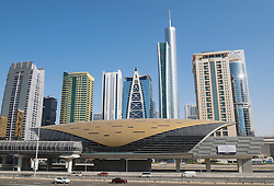 Metro station and skyscrapers at Jumeirah Lakes Towers (JLT) in Dubai United Arab Emirates