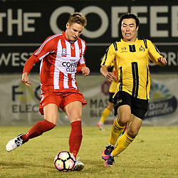 BRISBANE, AUSTRALIA - APRIL 13: Sam Cronin of Olympic FC and Kyusub Bang during the NPL Queensland Senior Men's Round 4 match between Olympic FC and Moreton Bay Jets at Goodwin Park on April 13, 2017 in Brisbane, Australia. (Photo by Patrick Kearney/Olympic FC)