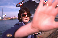 AI hate it when this happens.  A very imprtant Public Relations person did not want me to take a picture of the carrier Theodore Roosevelt  the day befor the christenianing.  I forgetr the reason, but she was over ruled shortly after I made this picture. <br />Photograph ny Dennis Brack. bb78