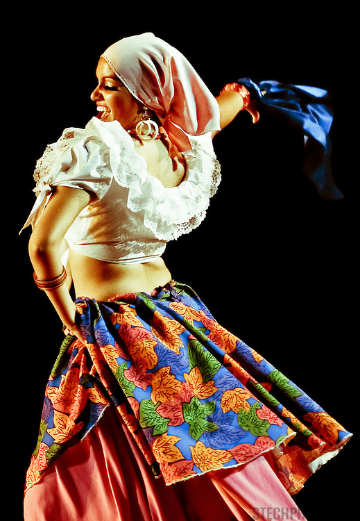 A female dancer from Slovakia performing a gypsy number at a folk dance festival in Tarcento, Italy.
