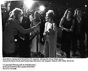 Joan Rivers being interviewed by T.V. reporter  during the Oscar Night party hosted by Steve Tisch and Vanity Fair. Morton's. Los Angeles. March 1995. Film. 95532/18<br />© Copyright Photograph by Dafydd Jones<br />66 Stockwell Park Rd. London SW9 0DA<br />Tel 0171 733 0108