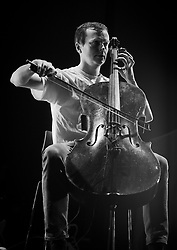 Oliver Coates performing live at The Roundhouse supporting Thom Yorke 8th June 2018 <br /> <br /> Oliver Coates is a cellist and producer from London. His concerts and records move through different arenas of music. His recent releases include a solo electronic dance record, Upstepping, on PRAH, a record of improvisations, Remain Calm, with Mica Levi on Slip, and a recording of John Luther Adams' Canticles of the Sky on RVNG Intl.<br /> <br /> For many years he has collaborated with the visual artist Lawrence Lek, for whom he scored the award-winning video pieces Unreal Estate and QE3. He conceived and programmed the Southbank Centre's first DEEP∞MINIMALISM festival in 2016, which featured Pauline Oliveros' last public Tuning Meditation.<br /> <br /> He has performed with Terry Riley, Steve Reich, Jonny Greenwood, Mica Levi and Actress, and is currently working with Laurie Spiegel and John Luther Adams. He has appeared at festivals including Big Ears (US), Documenta (GR), OFF (PL), Rewire and Le Guess Who (NL), Bad Bonn Kilbi (CH), Borealis (NO), Semibreve (PT), and Green Man, Latitude, Glasgow International and the Liverpool International Festival of Psychedelia (UK) and has performed cello concertos across Europe and the Far East. In 2017 he supported Radiohead at Old Trafford Cricket Ground and in 2018 he will support Thom Yorke across Europe.<br /> <br /> He has been artist in residence at Southbank Centre, is principal cello with London Contemporary Orchestra and last year composed a full-length concert work for strings and pre-recorded sound for theatre performance, Shorelines, based on the North Sea Flood of 1953. <br /> <br /> Photograph by Elliott Franks