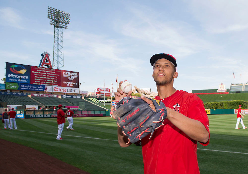 Andrelton Simmons looks to throw a ball to students during the Orange County Gang Reduction and Intervention Partnership Angels game Tuesday.<br /> <br /> ///ADDITIONAL INFO:   <br /> <br /> angels.0427.kjs-pre  ---  Photo by KEVIN SULLIVAN / Orange County Register  --  4/26/16<br /> <br /> The Los Angeles Angels take on the Kansas City Royals Tuesday at Angel Stadium.<br /> <br /> <br />  4/26/16