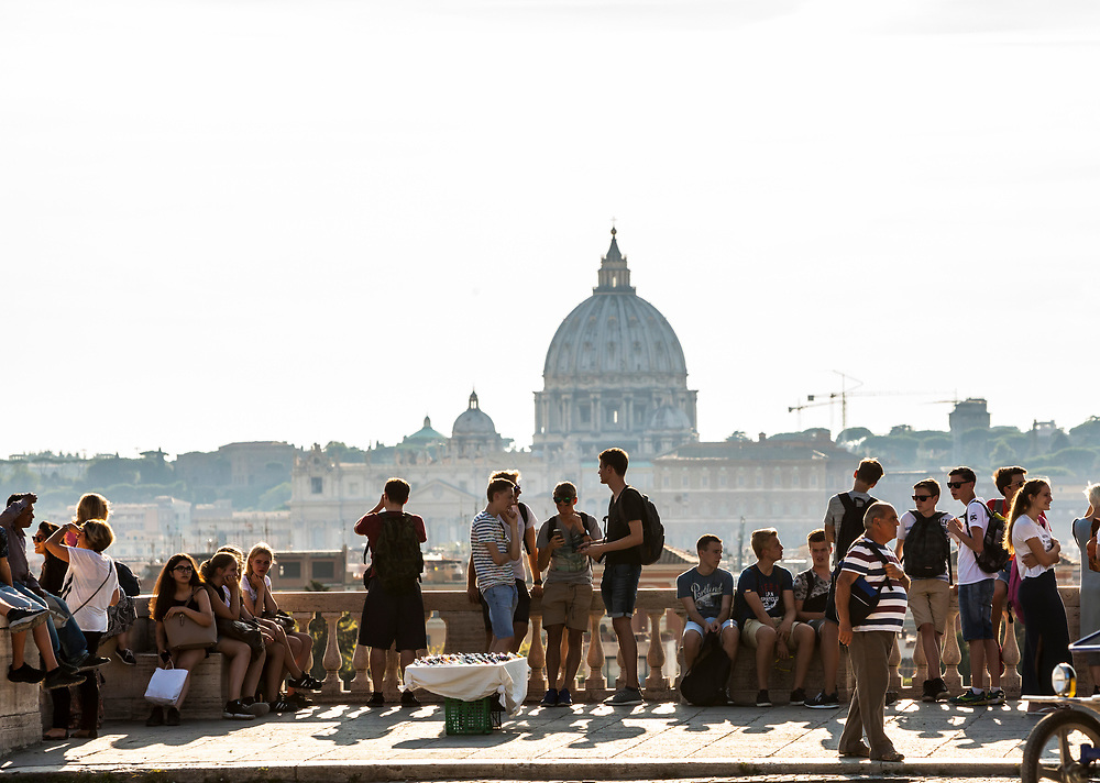 Tourists in Borghese Park overlooking Rome with St Peters Basilica in the distance.
