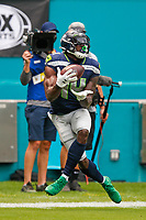 Seattle Seahawks wide receiver DK Metcalf (14) catches the ball during an NFL football game against the Miami Dolphins, Sunday, Oct. 4, 2020 in Miami Gardens, Fla.<br /> <br /> ( Tom DiPace via AP)
