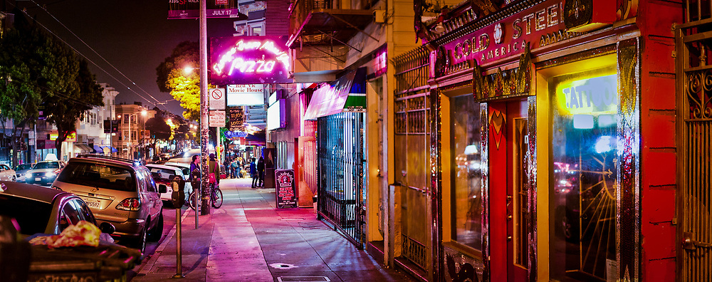 Escape from New York Pizza glows on a typical night along Haight Street in San Francisco.