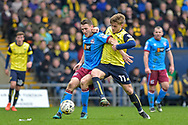 Scunthorpe United Defender, Murray Wallace (5) and Oxford United Forward, Conor McAleny (11) during the EFL Sky Bet League 1 match between Oxford United and Scunthorpe United at the Kassam Stadium, Oxford, England on 18 March 2017. Photo by Adam Rivers.