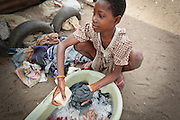 A girl hand washes clothes in the Point Four neighborhood of Monrovia, Montserrado county, Liberia on Thursday April 5, 2012.