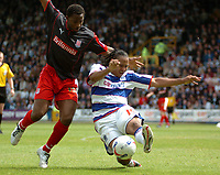 Photo: Tony Oudot.<br /> Queens Park Rangers v Stoke City. Coca Cola Championship. 06/05/2007.<br /> Dominic Shimmin of Queens Park Rangers beats Vincent Pericard of Stoke to the ball