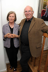 CLIVE JAMES and his wife PRU at a private view of paintings by Laura Smith at 54 The Gallery, Shepherd Market, London W1 on 8th July 2008.<br /><br />NON EXCLUSIVE - WORLD RIGHTS