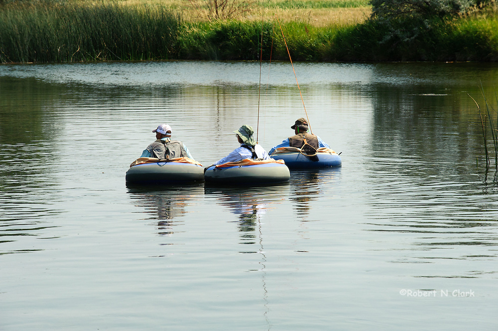 Fishing Guide and clients float tubing Silver Creek