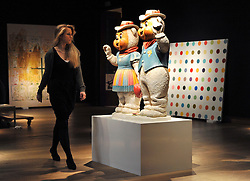 ©London News pictures. 08.02.2011. A woman walks past a sculpture by Jeff Koons entitled Winter Bears, estimated to fetch 2.5-3.5million at auction.  A preview, today (Fri) of Christie's Auction House Post-War and Contemporary Art Evening Auction. The sale is expected to make a combined total of £46,246,000 to £66,447,000 when it is sold on 16th Feb 2011.. Picture Credit should read Stephen Simpson/LNP