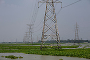 Electricity pylons stand in water on the flood plains next to the Turag river on the 1st of October 2018  in the Ashulia district of Dhaka, Bangladesh. (photo by Andrew Aitchison / In pictures via Getty Images)